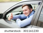 man doing thumbs up in car | Shutterstock . vector #301161230