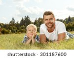 portrait of happy young father... | Shutterstock . vector #301187600