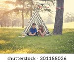 two children are sitting in a... | Shutterstock . vector #301188026