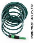 garden hose coiled on plain... | Shutterstock . vector #301199540
