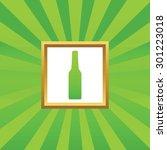 image of bottle in golden frame ...