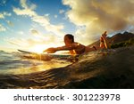 Surfing At Sunset. Outdoor...