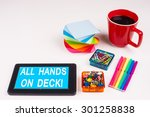 Small photo of Business Term / Business Phrase on Tablet PC - Colorful Rainbow Colors, Cup, Notepad, Pens, Paper Clips, White surface - White Word(s) on a cyan background - All Hands On Deck!