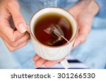 woman holding a warm cup of... | Shutterstock . vector #301266530