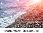 beach with wave and pebbles ... | Shutterstock . vector #301306340