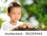 thin focus at asian boy hand... | Shutterstock . vector #301335443