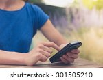 a young woman is sitting at at... | Shutterstock . vector #301505210