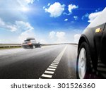 blurred car on icy road with sky | Shutterstock . vector #301526360
