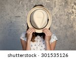 Stock photo young girl with hat hides her face depression photo tinted and styled with vintage photo 301535126