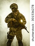 Small photo of United States paratrooper airborne infantry in the smoke