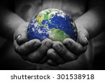 man holding an earth globe in... | Shutterstock . vector #301538918