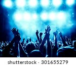 Stock photo silhouettes of concert crowd in front of bright stage lights a small depth of field signifies 301655279