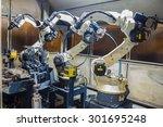 robots welding team in the... | Shutterstock . vector #301695248