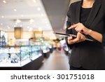 businesswoman using digital... | Shutterstock . vector #301751018