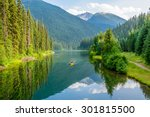 Small photo of Majestic mountain lake in Canada. Lightning Lake in Manning Park in British Columbia. Boat.