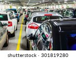rows of parked cars on a ferry... | Shutterstock . vector #301819280