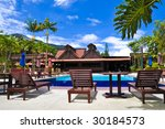 Swimming Pool at Tropical Resort - stock photo