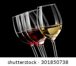 Four Wine Glasses With Wine On...