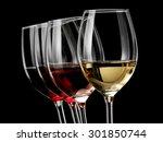 Four Wine Glasses On Black...