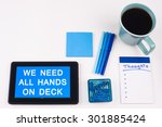 Small photo of Business Term / Business Phrase on Tablet PC - Blues, cup of coffee, Pens, paper clips Calculator with a blue note pad on a White Background - White Word(s) on blue - We Need All Hands On Deck