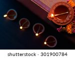 traditional clay diya lamps lit ... | Shutterstock . vector #301900784