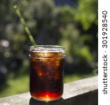 Ice Coffee In A Mason Jar With...