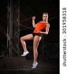 young sporty woman in orange... | Shutterstock . vector #301958318