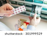 closeup hands of pharmacist man ... | Shutterstock . vector #301999529