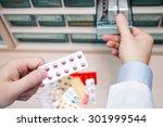 closeup hands of pharmacist man ... | Shutterstock . vector #301999544