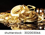 bunch of gold jewelry against... | Shutterstock . vector #302003066