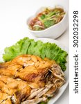 Small photo of Fried snapper with chili sauce in blue dish against bamboo background,Fried snapper fish