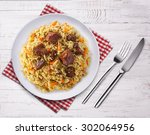 fragrant pilaf with meat and... | Shutterstock . vector #302064956