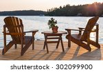 chairs on a deck overlooking a... | Shutterstock . vector #302099900