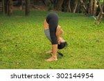 young woman doing yoga... | Shutterstock . vector #302144954
