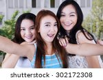 gorgeous female students taking ... | Shutterstock . vector #302172308