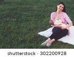 breastfeeding. mother feeding... | Shutterstock . vector #302200928