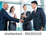 business handshake in lofty... | Shutterstock . vector #302201210