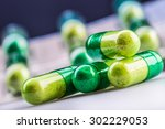 Green Yellow Pills Or Capsule...