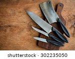 Set Of Kitchen Knifes On Woode...