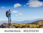 guy with a travel backpack on... | Shutterstock . vector #302253233