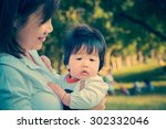 baby with young mother outdoor  ... | Shutterstock . vector #302332046