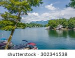 lake lure and chimney rock... | Shutterstock . vector #302341538