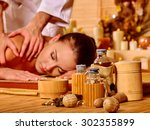 woman getting  massage in spa. | Shutterstock . vector #302355899