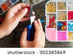 making of handmade jewellery.... | Shutterstock . vector #302385869