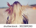 back view of the young female... | Shutterstock . vector #302389283