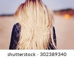 back view of the young female... | Shutterstock . vector #302389340