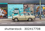 Stock photo berlin germany july berliner mauer berlin wall at east side gallery with an old trabant 302417708