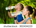 man and woman drinking water... | Shutterstock . vector #302434223