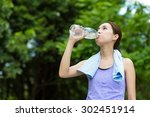 sporty woman drink water at... | Shutterstock . vector #302451914
