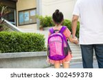 Small photo of Father Walking To School With Children